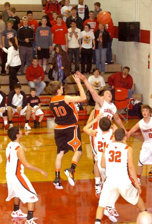 Terence Pierce of Gravette dribbled into the lane to get off a high-percentage shot over four Farmington defenders. The Gravette senior boys basketball team won a conference game, 62-45, at Farmington on Jan. 10.