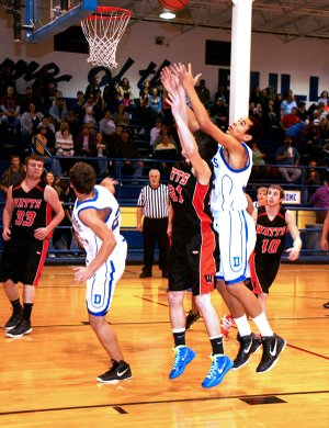 Decatur junior Andrew Harris stretched for a rebound during Friday's game against Watts.