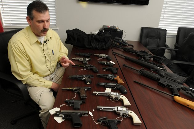 lt-cecil-white-detective-with-the-springdale-police-department-talks-about-several-guns-recovered-in-a-raid-of-a-rogers-home-rogers-friday-jan-20-2012-at-a-press-conference-in-the-springdale-criminal-investigation-building-in-springdale-members-of-the-rogers-police-department-recovered-15-handguns-and-four-long-guns-that-were-stolen-from-sturms-indoor-gun-range-in-springdale-earlier-in-the-week
