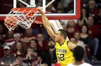 Michigan forward Jordan Morgan dunks against Arkansas during Saturday's game at Walton Arena in Fayetteville. Morgan finished with 16 points as the Wolverines found their rhythm in the second half and reduced Arkansas' 20-point lead to a two-point victory.