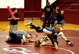 Photo by Randy Moll  Tyler Easter pins his opponent during wrestling on Friday in Gentry to seal Gentry's victory over Millington Central High School.