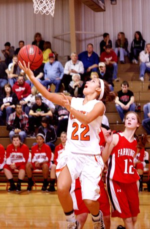 Samantha Pruitt attempts a layup under the basket in play against Farmington on Friday.