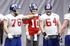 Former Arkansas linemen Tony Ugoh (70) and Mitch Petrus (62) work with other New York Giants linemen and quarterback Eli Manning during practice Friday. Ugoh and Petrus expect to see playing time today when the Giants meet the New England Patriots in the Super Bowl.