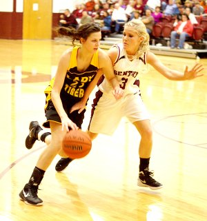 Gentry's Tara Arnold (right) guards against Prairie Grove's Justyne Huber during play in Gentry on Friday night, following colors day ceremonies.