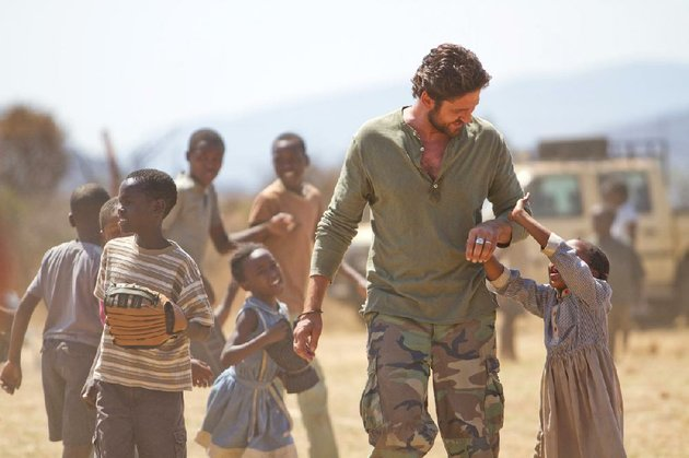 sam-childers-gerard-butler-is-willing-to-fight-to-protect-african-children-from-a-vicious-warlord-in-the-based-on-a-true-story-machine-gun-preacher
