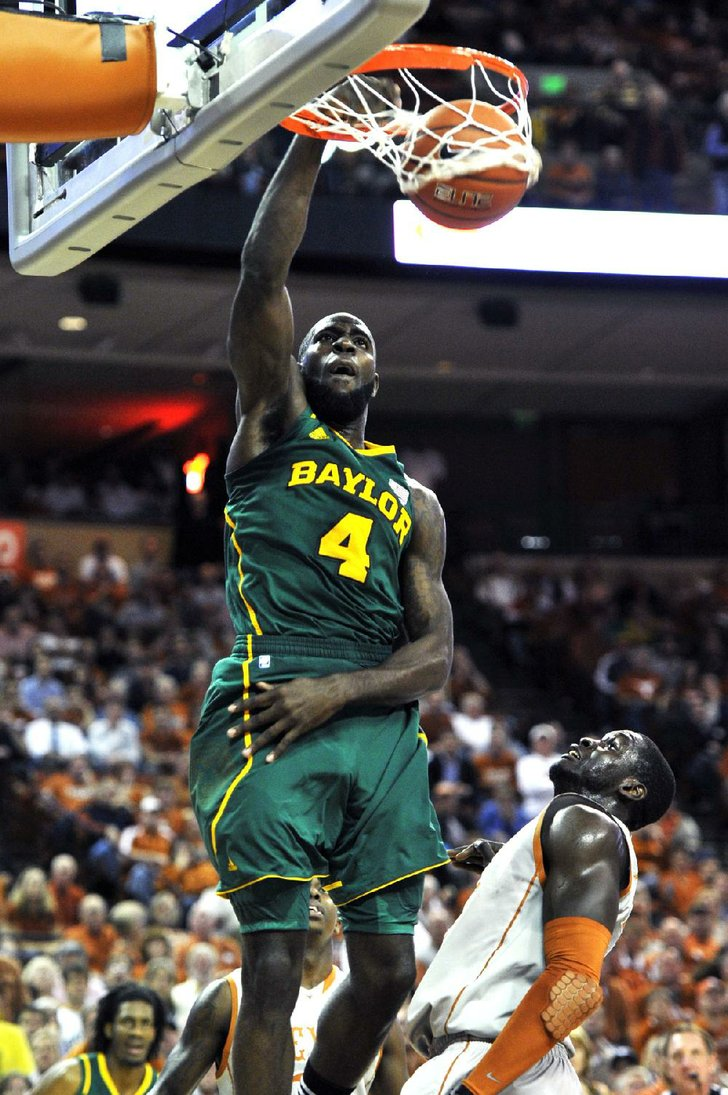 Baylor forward Quincy Acy (4) dunks over Texas forward ...