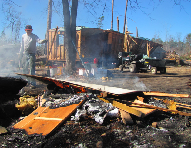 bennie-cox-works-to-dismantle-and-burn-a-trailer-that-was-destroyed-in-a-jan-22-tornado-in-fordyce