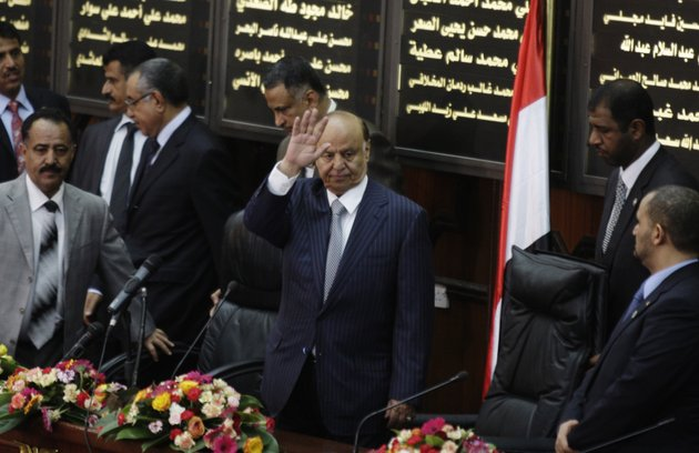 yemens-newly-elected-president-abed-rabbu-mansour-hadi-waves-as-he-arrives-to-the-parliament-in-sanaa-yemen-saturday-feb-25-2012-hadi-took-the-oath-of-office-before-the-countrys-parliament-saturday-he-replaces-ali-abdullah-saleh-who-ruled-the-country-for-33-years-before-leaving-office-in-a-power-transfer-deal-aimed-at-ending-more-than-a-year-of-political-turmoil