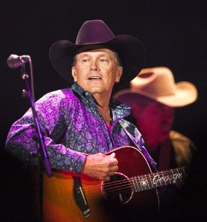 George Strait performs for the crowd at the Intrust Bank Arena in Wichita, Kansas, Saturday Feb. 18, 2012. (AP Photo/The Wichita Eagle/Kansas.com, Fernando Salazar)