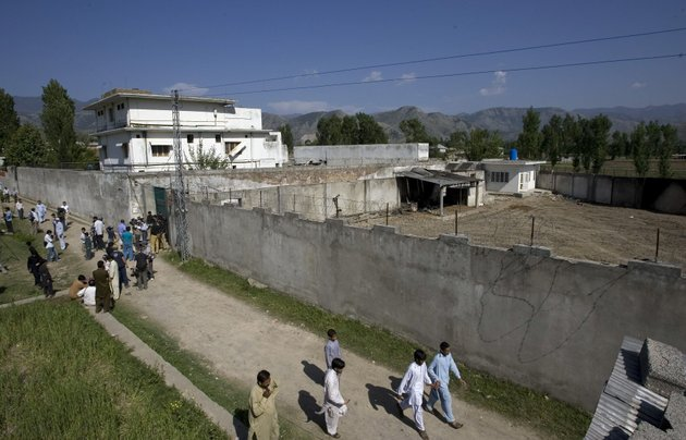 in-this-this-may-3-2011-file-photo-media-and-local-residents-gather-outside-the-compound-where-al-qaida-leader-osama-bin-laden-was-caught-and-killed-in-abbottabad-pakistan