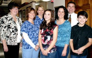 Pictured during the celebrating of his twenty years of dentistry business in Gravette, Dr. Kent Leonard and his wife Dorian and their children, Lauren and Cole, are shown on the right, along with the office staff, from the left, Roberta Yeagley, Kelley Hosteter and Lisa Pierce.