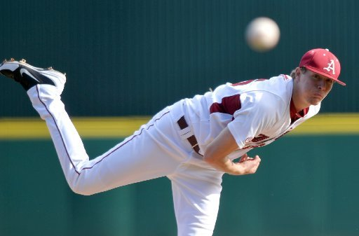 arkansas-democrat-gazettemichael-woods-03092012-university-of-arkansas-pitcher-ryne-stanek-fires-a-pitch-in-the-3rd-inning-of-friday-afternoons-game-at-baum-stadium-in-fayetteville