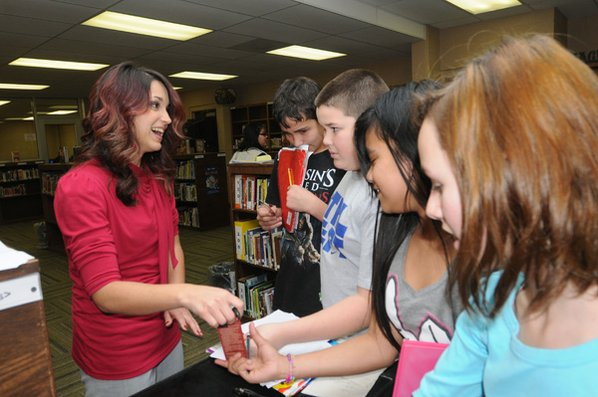 Author Tamara Heiner of Bella Vista autographs bookmarks Friday for students ...