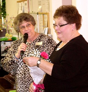 Jackie Bader, manager of the Gentry Senior Activity Center, presented flowers to volunteer Clara Garrett for all her help at the center.