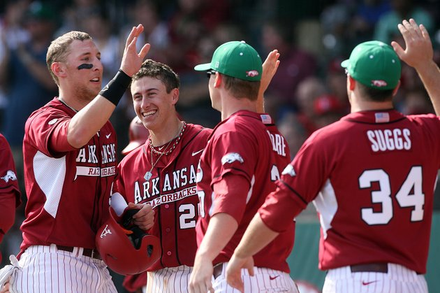 arkansas-democrat-gazettewilliam-moore-arkansas-outfielder-derrick-bleeker-is-greeted-at-the-duggout-by-teammates-from-left-dominic-ficociello-brandon-moore-and-colby-suggs-after-scoring-a-run-against-alabama-saturday-march-17-2012-at-baum-stadium-in-fayetteville