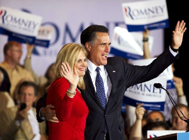 former-massachusetts-gov-mitt-romney-and-his-wife-ann-greet-a-crowd-tuesday-in-schaumburg-ill-after-romney-won-the-states-republican-presidential-primary