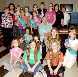 Gravette Girl Scouts celebrated the 100th anniversary of the Girl Scout organization March 12, with their leaders, Elaina Soper, Heather Holland, Lori Johnson, Teresa Reynolds and Nancy Jones. A special guest was Marie Wadleigh, 88, of Bella Vista who became a Girl Scout when she was ten years old.