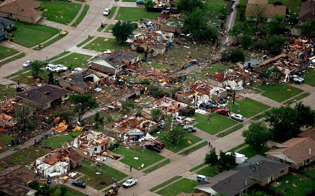 homes-in-lancaster-texas-lay-destroyed-by-a-tornado-on-tuesday-april-3-2012-tornadoes-tore-through-the-dallas-area-tuesday-peeling-roofs-off-homes-tossing-big-rig-trucks-into-the-air-and-leaving-flattened-tractor-trailers-strewn-along-highways-and-parking-lots-mags-out
