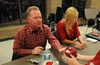 Head football Coach Bobby Petrino and Jessica Dorrell attended a fan event in Searcy on Feb. 23, 2012.