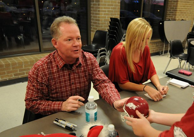 head-football-coach-bobby-petrino-and-jessica-dorrell-attended-a-fan-event-in-searcy-on-feb-23-2012