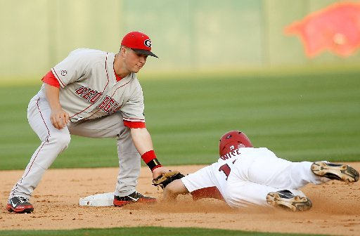 Arkansas Democrat-Gazette/JASON IVESTER --04/06/12 -- Arkansas' Jake Wise is tagged out by Georgia shortstop Kyle Farmer at second at Baum Stadium in Fayetteville on Friday, April 6, 2012.