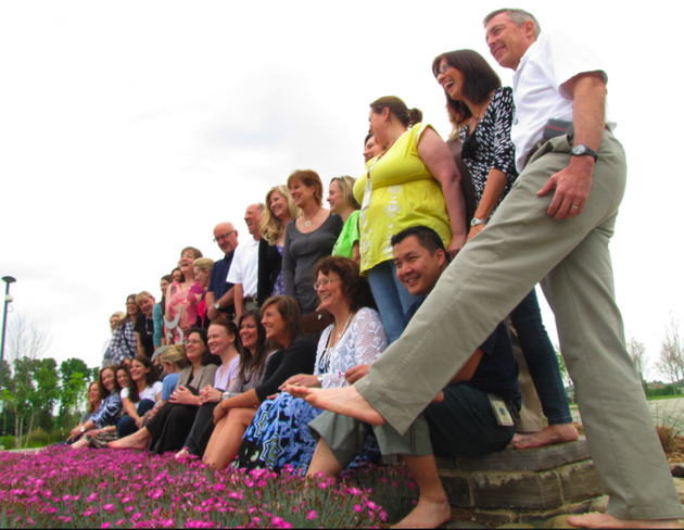 heifer-international-employees-who-went-barefoot-tuesday-as-part-of-a-worldwide-awareness-drive-gather-before-a-group-photograph