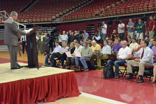 University of Arkansas Athletic Director Jeff Long address the media following the announcement of the firing of football coach Bobby Petrino Tuesday evening at Bud Walton arena in Fayetteville.