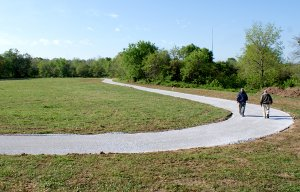 These two Gravette walkers, Al Dunagin and John Richard Meade, tried out the new portion of the walking trail at Pop Allum Park in Gravette last week. The entire trail will be handicap friendly with a smooth asphalt surface and an access ramp at the trail-head. The new surface joins an older trail which is also being paved.