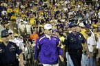 Louisiana State Police have been handling security on a volunteer basis for an LSU football coach since the late 1970s.