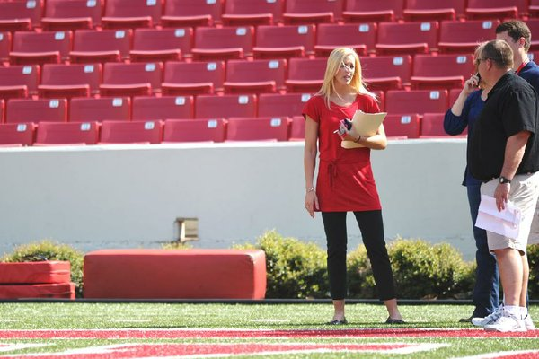 Eight months after resigning her position on the Arkansas football staff, Jessica Dorrell has landed a new job after moving to South Carolina. She is shown here at Reynolds Razorback Stadium in March.