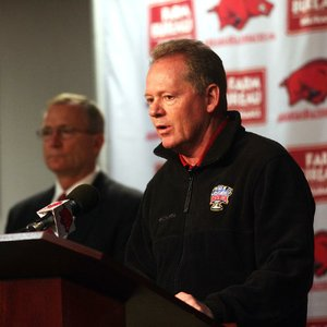 Former football Coach Bobby Petrino is shown last year with Athletic Director Jeff Long (left) at the Broyles Athletic Center on campus in Fayetteville.
