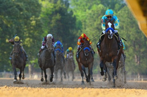 arkansas-democrat-gazettestephen-b-thornton-4142012-mike-smith-aboard-bodemeister-right-raises-up-as-he-crosses-the-finish-line-ahead-of-the-pack-to-win-the-arkansas-derby-during-saturday-afternoons-race-at-oaklawn-park-in-hot-springs