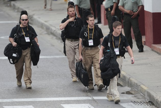 us-secret-service-agents-walk-around-the-convention-center-in-cartagena-colombia-prior-to-the-opening-ceremony-of-the-6th-summit-of-the-americas-at-the-convention-center-in-cartagena-colombia-saturday-april-14-2012-last-thursday-a-dozen-secret-service-agents-sent-to-provide-security-for-us-president-barack-obama-were-relieved-from-duty-and-replaced-with-other-agency-personnel-after-an-incident-of-alleged-misconduct