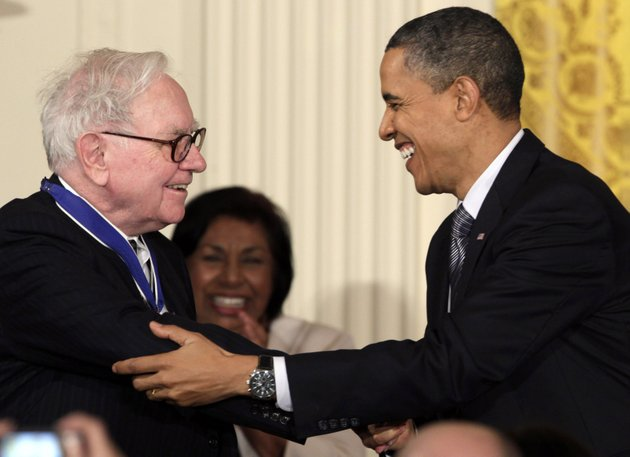 in-this-feb-15-2010-file-photo-president-barack-obama-congratulates-warren-buffett-after-presenting-him-with-a-2010-presidential-medal-of-freedom-in-an-east-room-ceremony-at-the-white-house-in-washington-in-his-weekly-radio-and-internet-address-saturday-april-14-2012-obama-urged-americans-to-ask-their-member-of-congress-to-support-the-buffett-rule-named-after-the-billionaire-investor-who-says-he-pays-a-lower-tax-rate-than-his-secretary-obama-says-the-nation-cant-afford-to-keep-giving-tax-cuts-to-the-wealthiest-who-dont-need-them-and-didnt-even-ask-for-them