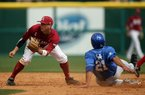 Kentucky's Luke Maile (21) steals second base while Arkansas second baseman Bo Bigham waits for a late throw from home plate during the Wildcats' 5-4 victory Saturday in the first game of a doubleheader at Baum Stadium in Fayetteville.