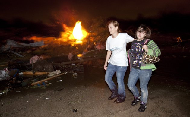 two-people-walk-past-a-gas-fire-in-the-pinaire-mobile-home-park-in-wichita-kansas-on-saturday-april-14-2012-after-a-tornado-caused-massive-destruction-in-the-area-on-saturday-night