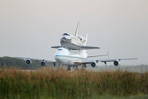 space-shuttle-discovery-atop-a-747-carrier-jet-departs-the-kennedy-space-center-tuesday-april-17-2012-in-cape-canaveral-fla
