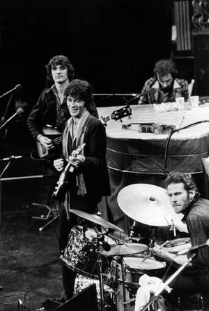 "In this Nov. 27, 1976 file photo, The Band, Richard Manuel on piano, Levon Helm on drums, lead guitarist Robbie Robertson, center, and bass guitarist Rick Danko, take the stage for their final live performance before a crowd of 5,000 at Winterland Auditorium in San Francisco. A message posted Tuesday, April 17, 2012 on Levon Helm's website by his family says ""Levon is in the final stages of his battle with cancer."""