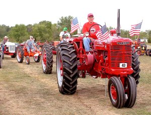 Don Hevener, on his 1948 Farmall tractor, leads a group of tractors — Don Gilbert, followed by Gene Wietzel on the G Allis Chalmers — by the bleachers during the Parade of Power held during the fall show in September of 2011. The 20th annual Spring Crank-up will begin on Friday at the Tired Iron showgrounds on Taylor Orchard Road south of Gentry.