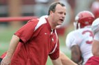 University of Arkansas Tim Horton works with the team during Friday afternoons practice at Razorback Stadium.