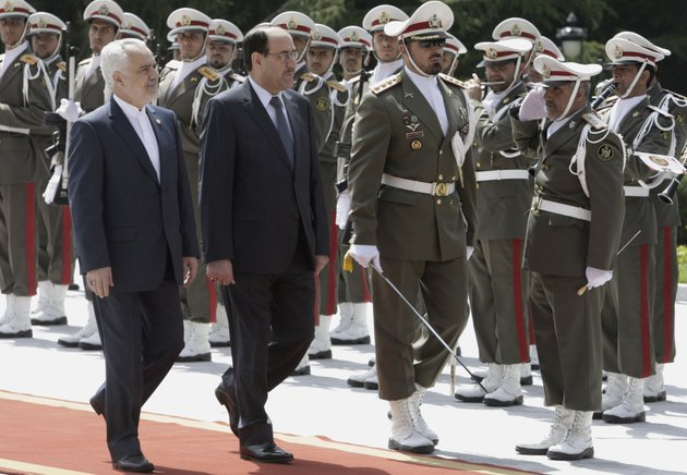 iraqi-prime-minister-nouri-al-maliki-center-reviews-an-iranian-honor-guard-as-he-is-accompanied-by-iranian-vice-president-mohammad-reza-rahimi-left-during-an-official-arrival-ceremony-in-tehran-iran-sunday-april-22-2012