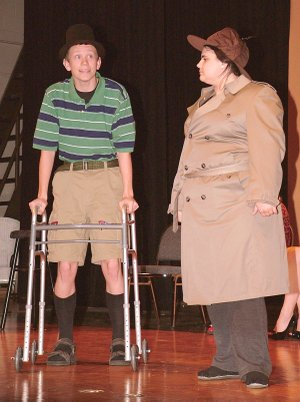 """Brandon Brigance, playing a decrepit invalid, is questioned by the inspector, Emily Bond, during rehearsal for the upcoming performance of """"Murder in the Knife Room,"""" to be performed by drama students at Gentry High School on April 26."""