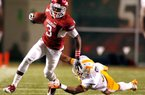 Arkansas wide receiver Joe Adams tries to slip out of a tackle attempt from Tennessee defensive back Byron Moore during the third quarter at Donald W. Reynolds Razorback Stadium in Fayetteville on Saturday, Nov. 12, 2011.
