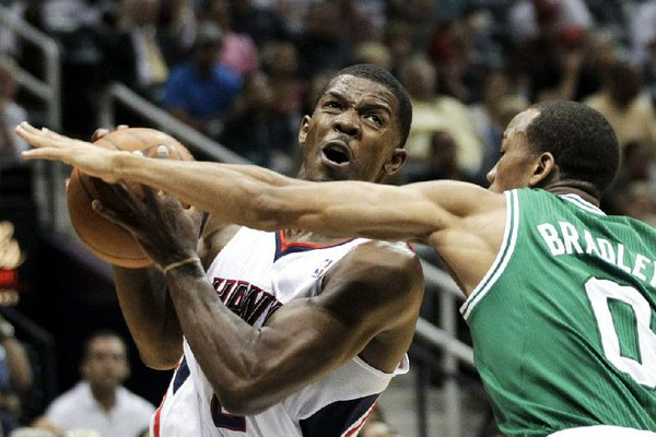 FILE - Atlanta guard Joe Johnson (Arkansas Razorbacks/Little Rock Central) plays against the Boston Celtics in the first round of the NBA playoffs in April.