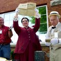 Toinette Madison, director of the Boone County Heritage Museum, holds a copy of the April 27, 1912, ...