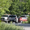A red car involved in a shooting is hooked to a tow truck on High Sky Inn Road, Tuesday, May 2, 2012...