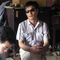 In this undated photo released by supporters of Chen Guangcheng, blind activist Chen Guangcheng, cen...