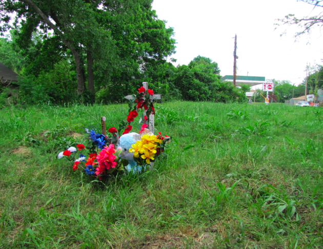 a-small-memorial-stands-for-michael-stanley-jr-in-the-grassy-lot-where-he-was-struck-by-a-van-and-beaten-after-a-chase