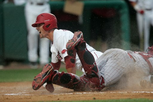arkansas-democrat-gazetteryan-mcgeeney-05-04-2012-razorbacks-3rd-baseman-matt-reynolds-slides-safe-into-home-during-the-third-inning-of-friday-nights-game-against-south-carolina-at-baum-stadium-in-fayetteville