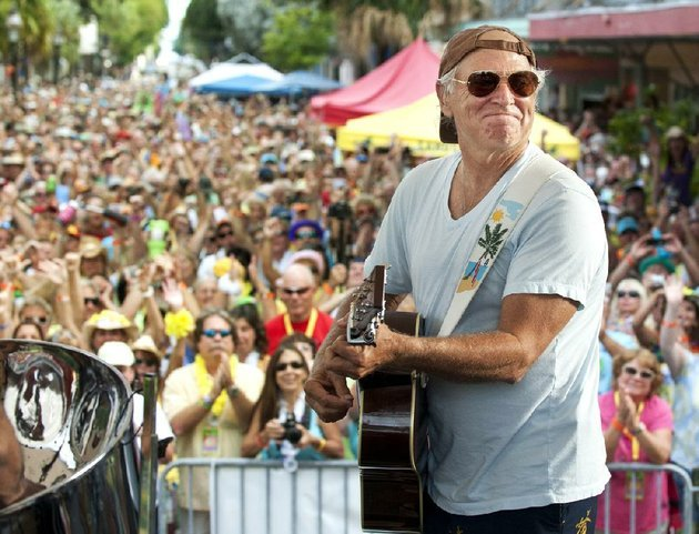 in-this-friday-nov-4-2011-photo-provided-by-the-florida-keys-news-bureau-singersongwriter-jimmy-buffett-performs-before-some-3500-of-his-fans-on-duval-street-in-key-west-fla-ap-photoflorida-keys-news-bureau-rob-oneal